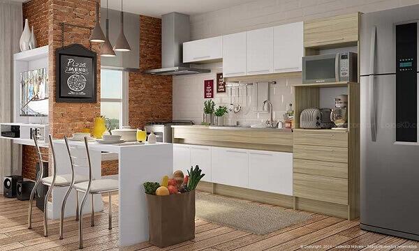 Cozinha americana pequena com tijolinhos na parede