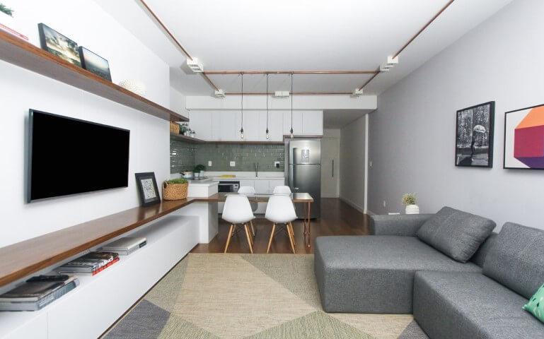 Decoração de sala com sofá com chaise Projeto de SP Estúdio