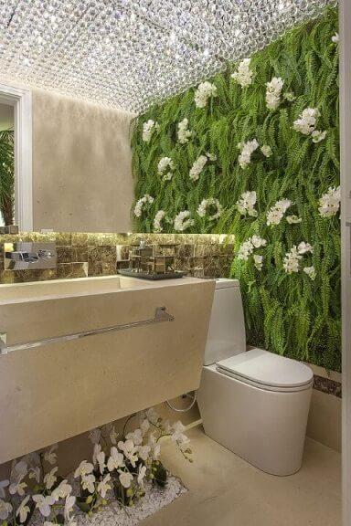 Lavabo com jardim suspenso com flores Projeto de Iara Kilaris