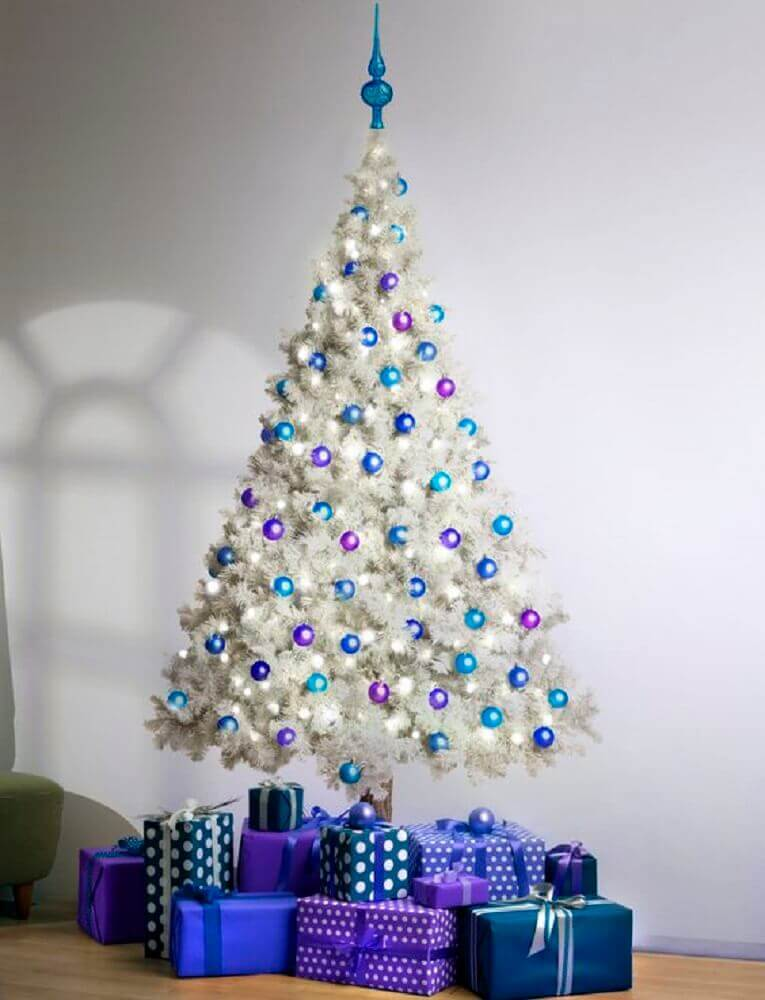 Simple decoration with purple and blue Christmas balls for white tree