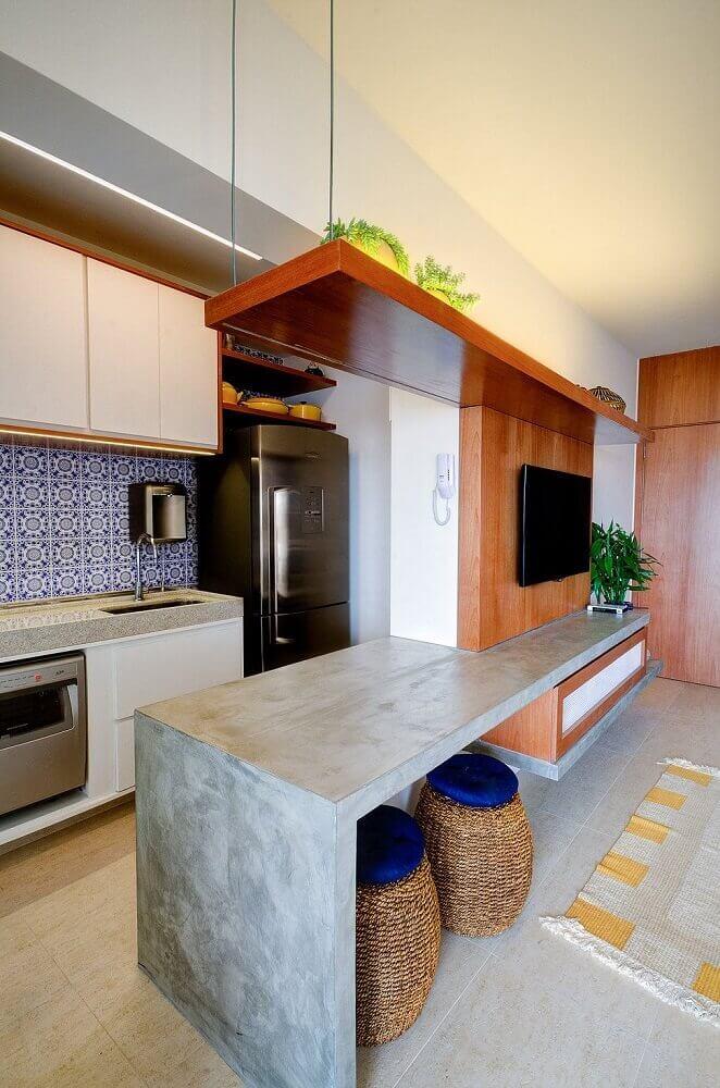 cozinha americana com sala moderna com bancada de cimento queimado Foto HGTV Decor