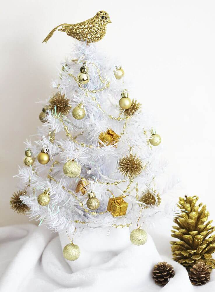 small white Christmas tree decoration with golden ornaments Photo The Holk