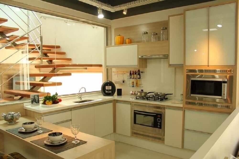 decoração em tons neutros com armário planejado para cozinha pequena Foto Isabela Nunes Mayerhofer