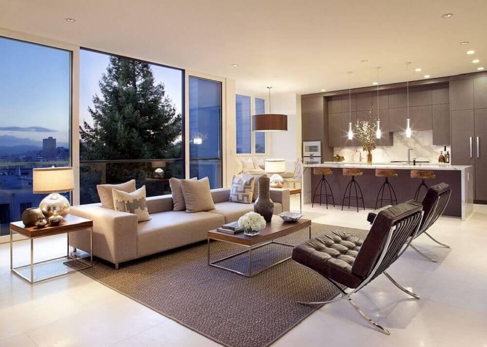 decoração sofisticada para cozinha integrada com sala de estar ampla Foto Usual House