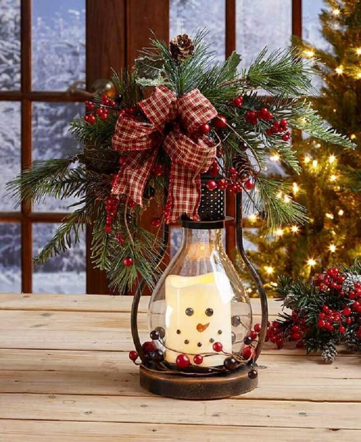 divertido arranjo de natal com vela imitando boneco de neve Foto Pinterest