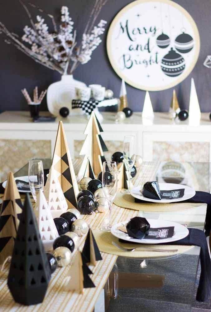 mesa de natal com decoração moderna com itens preto Foto Pinterest