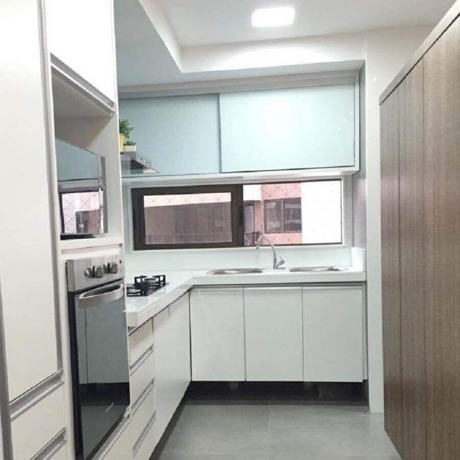 modelo de cozinha planejada para apartamento pequeno Foto Plural Consultoria e Arquitetura Criativa