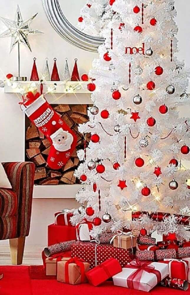 room decorated with white and red Christmas tree Photo Happy Holidays!