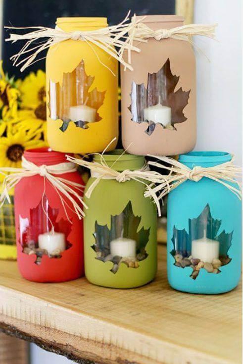 Enfeites feitos com velas de natal com potes de vidro pintados Foto de Firepont