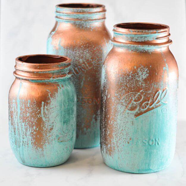 Potes de vidro decorados em tons de cobre e azul Foto de DIY Projects