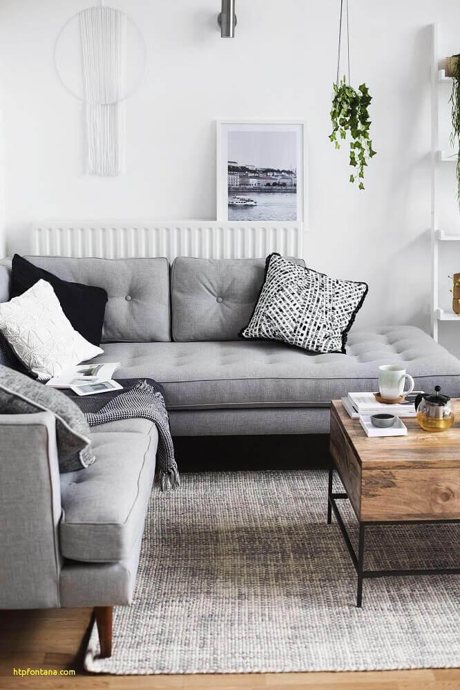 decoração minimalista com sofá em l para sala pequena Foto Fontana