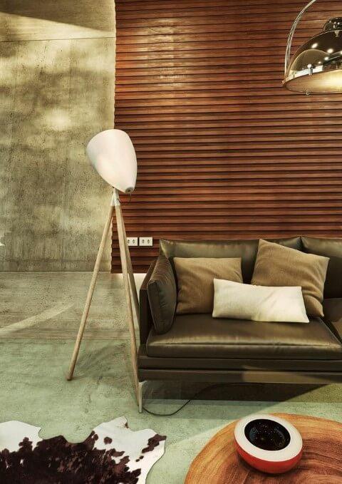Sofá de couro preto com pé de metal Projeto de Lumo Studio