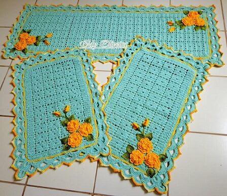 Jogo de cozinha de crochê azul turquesa com flores laranjas Foto de Idy Oliveira