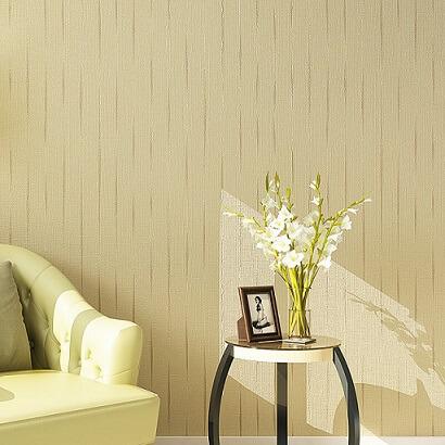Papel de parede cor palha e poltrona verde limão Foto de Loja Supremo