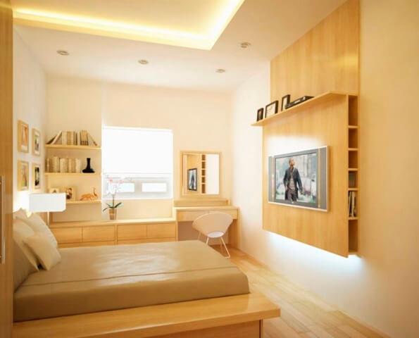 Quarto de solteiro com paredes cor palha e móveis de madeira Foto de Home Wall Decor