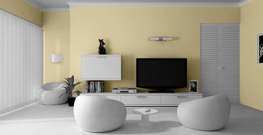 Sala de estar com parede cor palha e móveis brancos Foto de Tintas Lux