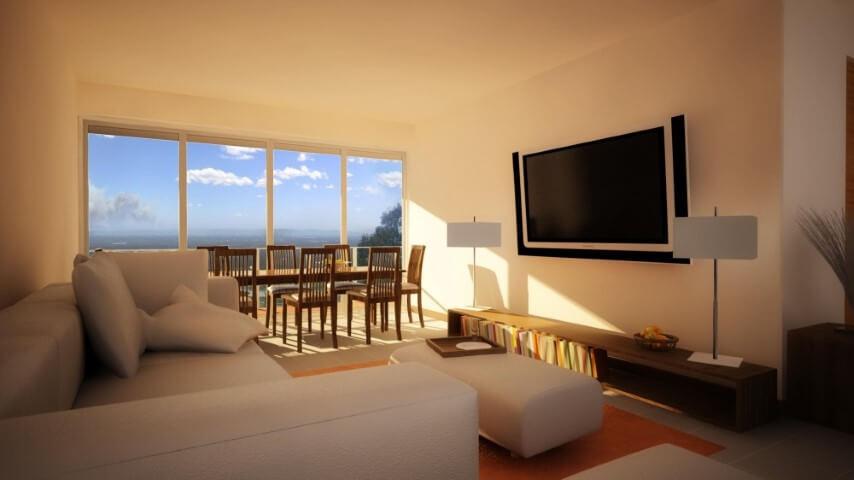 Sala integrada com paredes e teto na cor palha Foto de Essência Móveis de Design