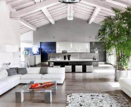 decoração sala ampla com sofá branco de canto
