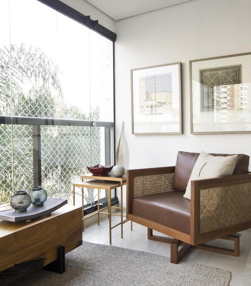 modelo diferente de poltrona para varanda com cortina de vidro Foto Marília Veiga