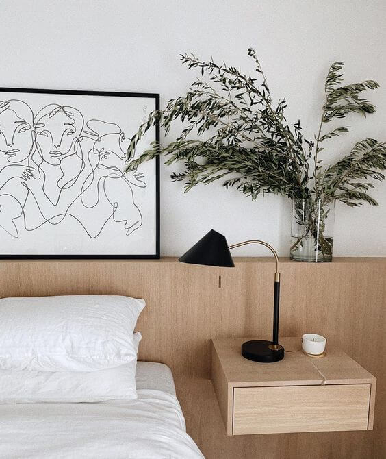 Quarto com molduras para quadros minimalistas