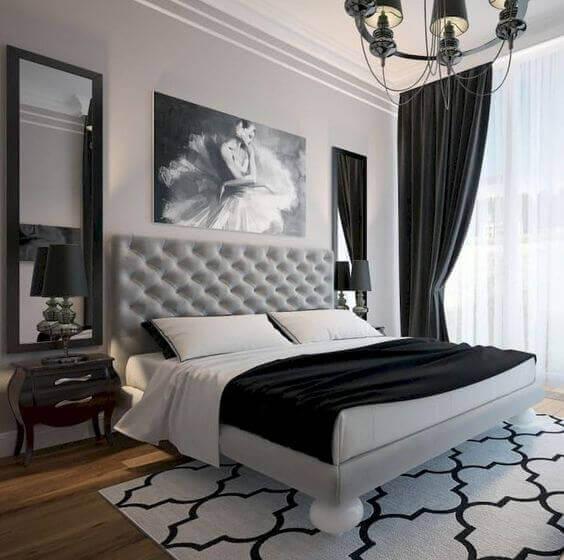 Quarto preto e branco com quadro sem molduras para quadros