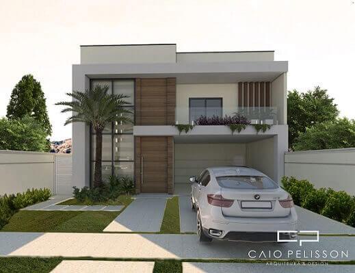Casa duplex pequena com uso de vidro e madeira Projeto de Caio Pelisson
