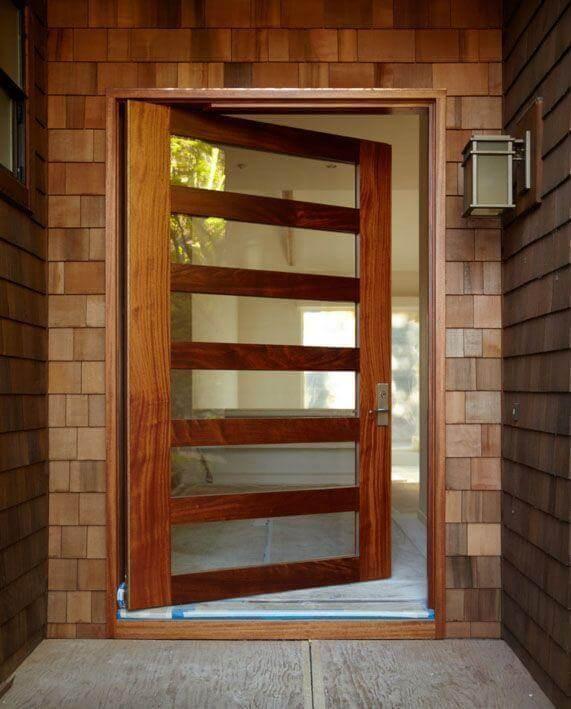 Porta pivotante de madeira com vidro Foto de Pivot Door Company