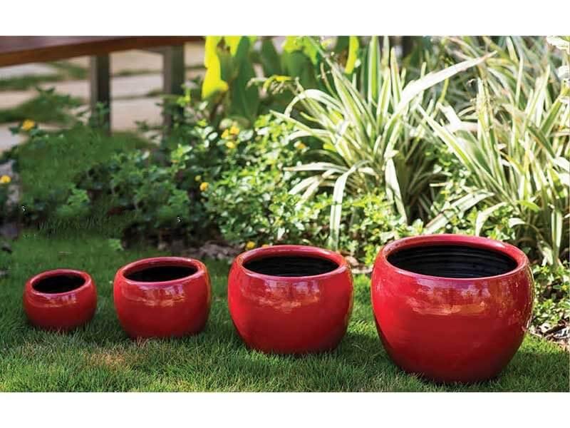 Vasos de cerâmica vermelhos em conjunto Foto de Terra Asia