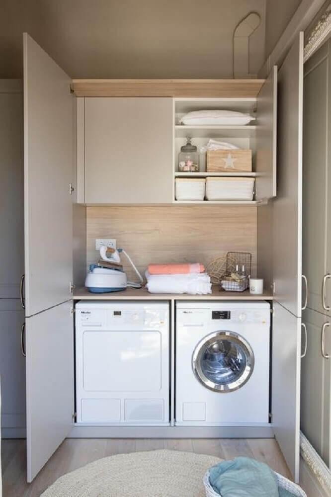 armário pequeno para lavanderia planejada com portas Foto El Mueble