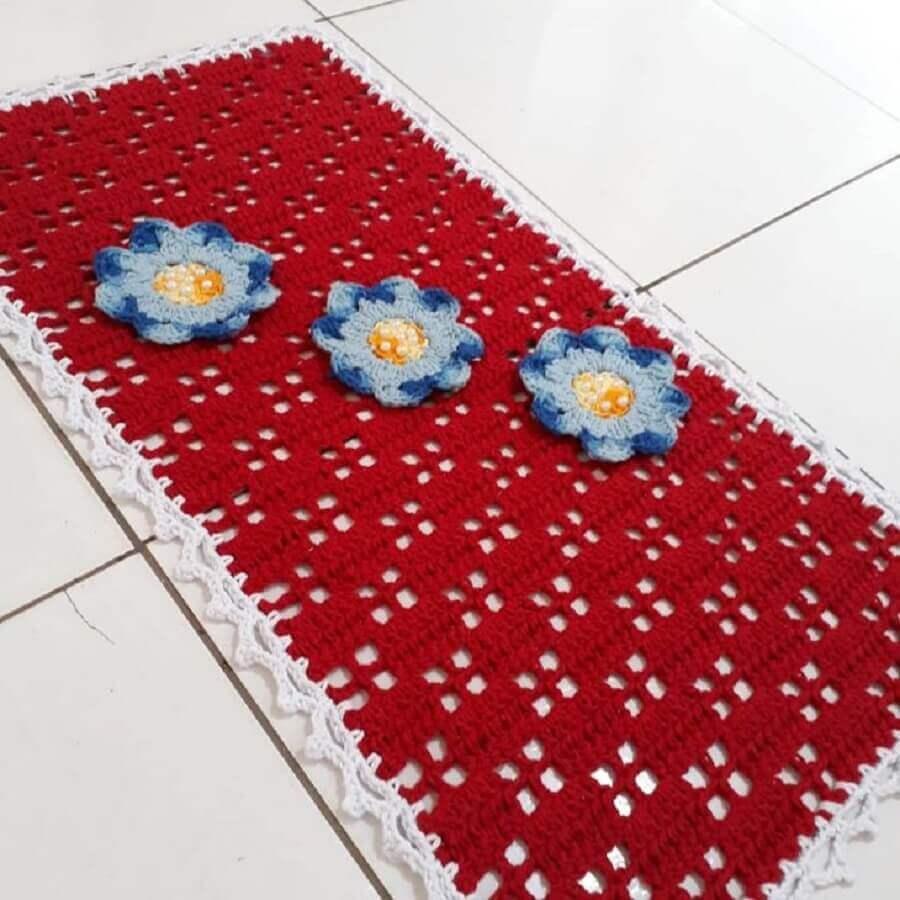 flor de crochê azul para tapete vermelho Foto Nubia Cruz Mar e Sol