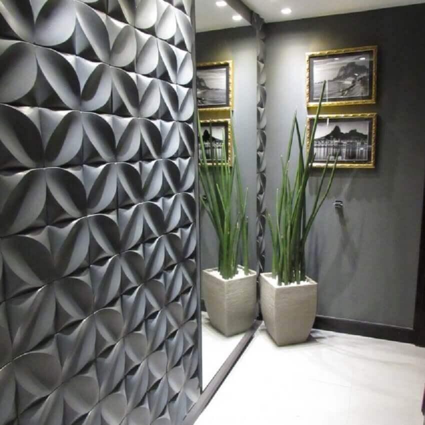 hall de entrada decorado com revestimento 3d e parede espelhada