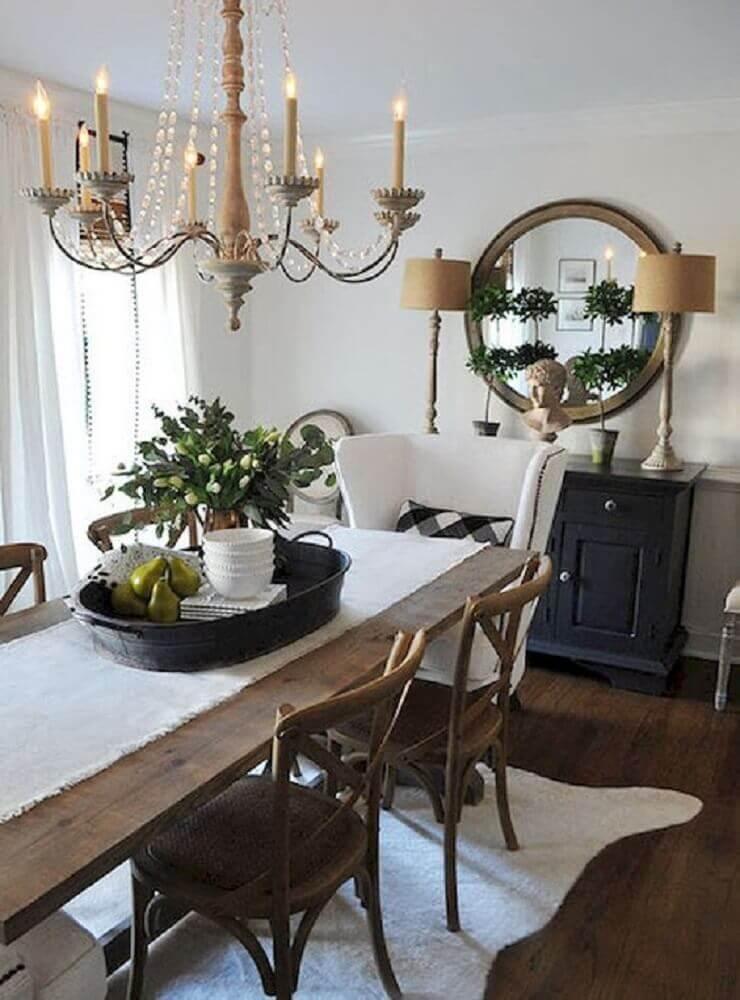lustre pendente para sala de jantar decorada com espelho redondo e mesa de madeira Foto Pinterest