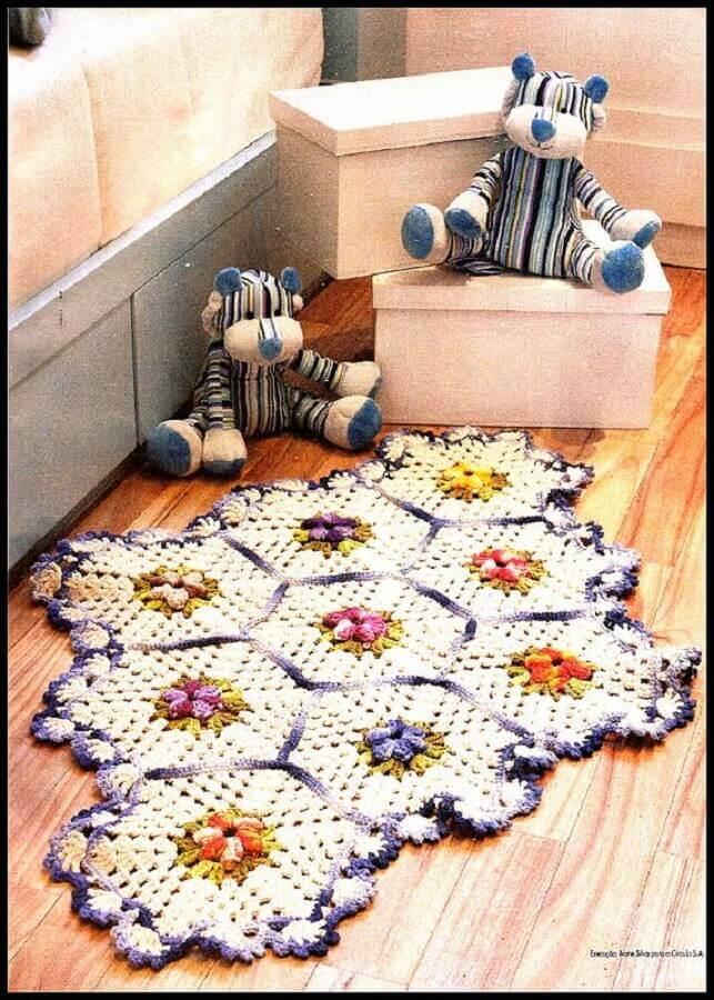modelo diferente de tapete de crochê com flores Foto Stylowi