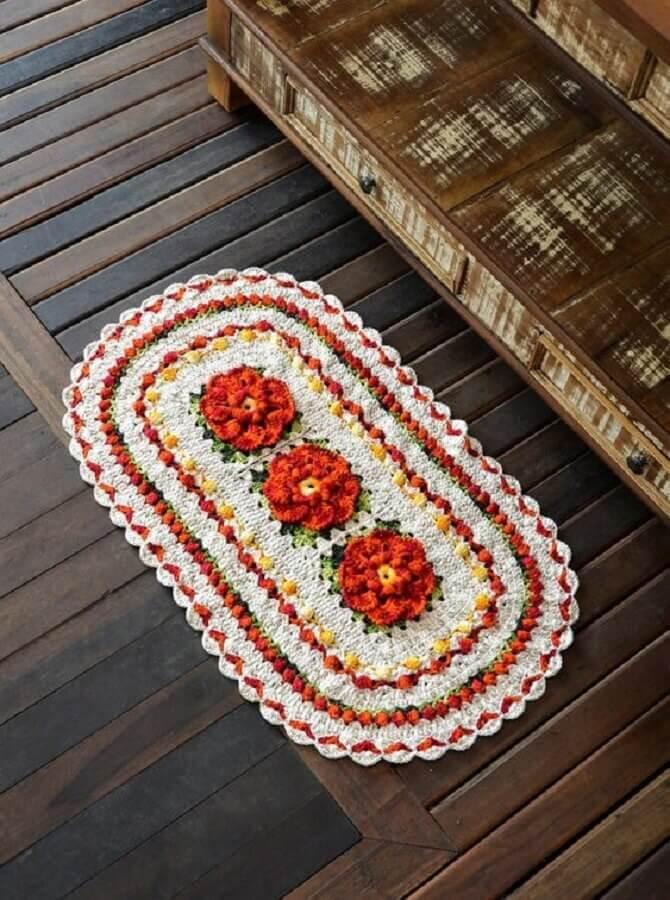 tapete crochê oval com flor laranja Foto Croche Supreme