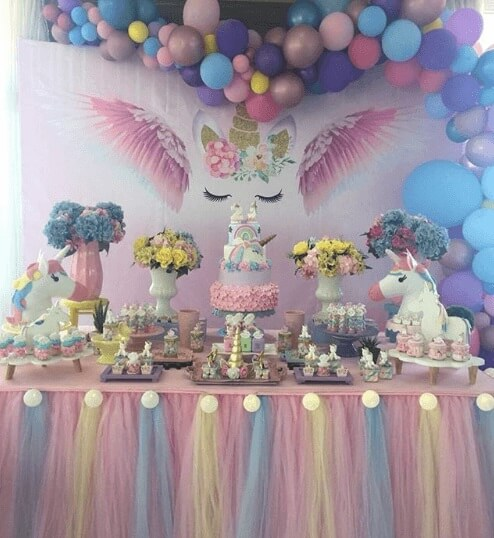 Festa de unicórnio com decoração da mesa de bolo em tons pastel Foto de Ideas Bonitas Para