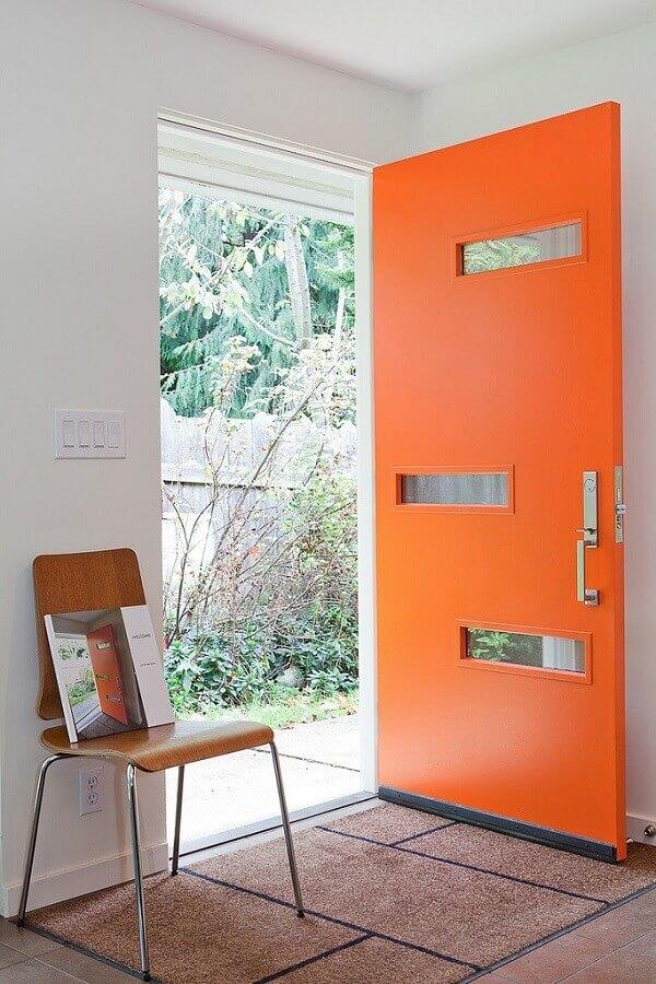 modelos de porta de entrada diferente pintada de laranja com recortes vazados Foto Pinterest