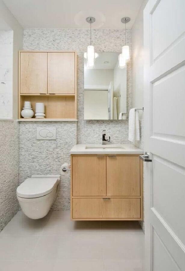 decoração com armário de madeira e cuba de embutir para lavabo Foto Mauricio Gebara Arquitetura