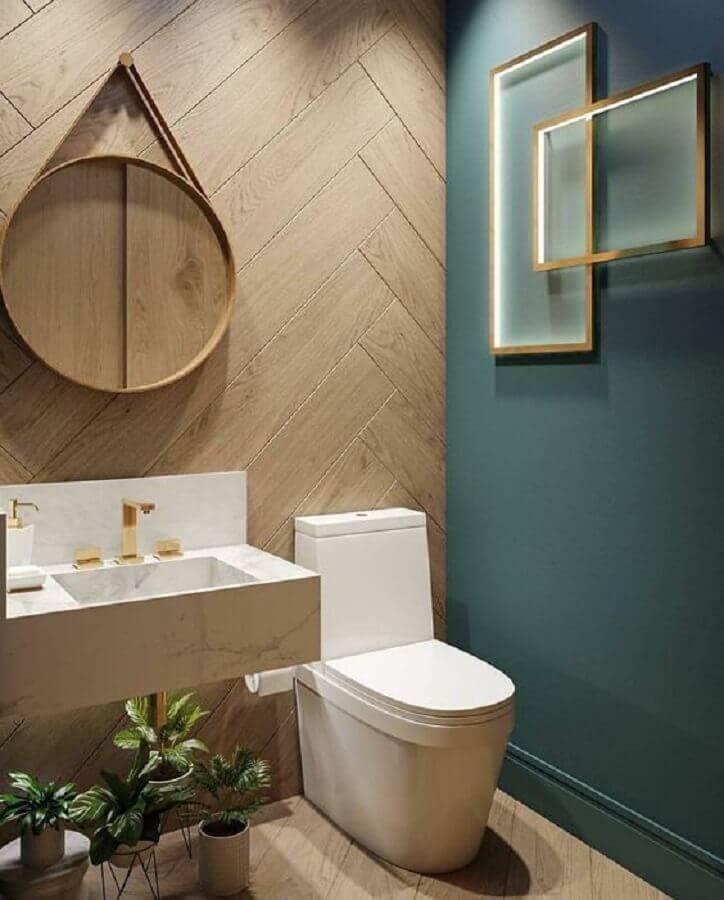 decoração com cuba pequena para lavabo com espelho redondo e torneira dourada  Foto Pinterest
