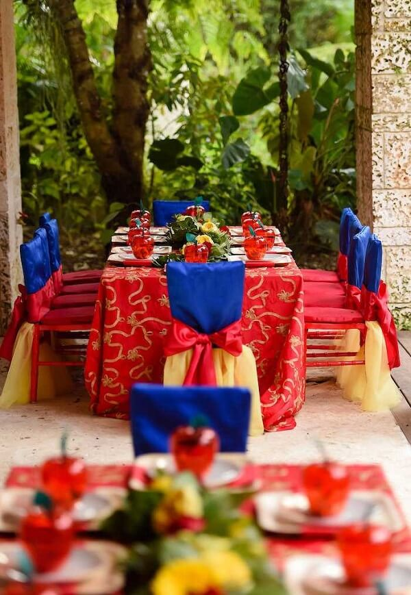 The decoration of the table catches the attention of Snow White's birthday party guests