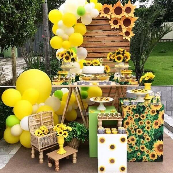 The sunflower theme birthday party adds a more rustic touch