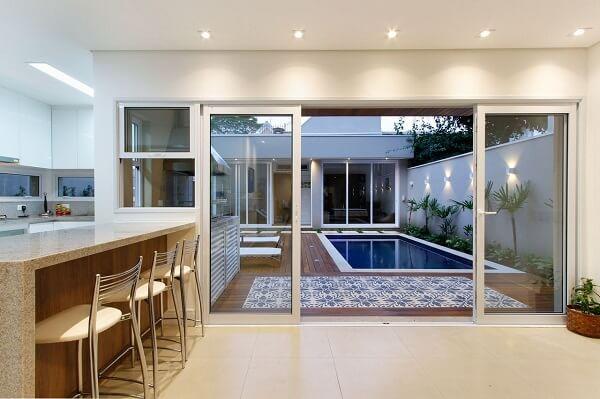 Separe os ambientes com portas de vidro