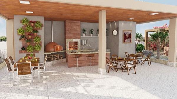 Edícula com churrasqueira em espaço decorado