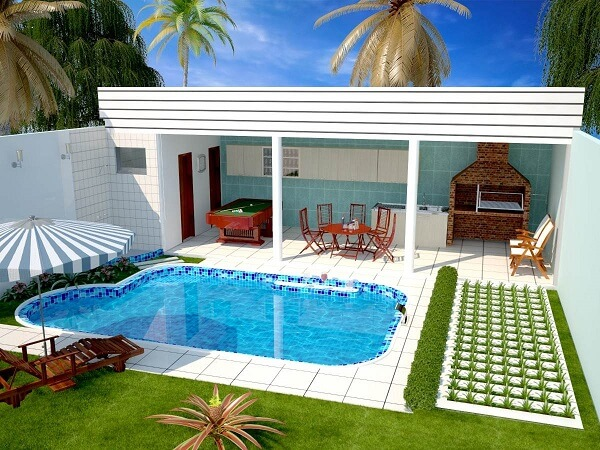 Edícula com churrasqueira em projeto inclui piscina e banheiro