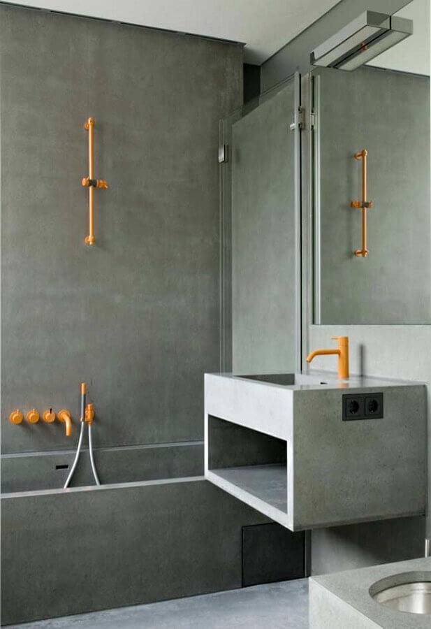 banheiro masculino com cimento queimado decorado com detalhes em amarelo Foto Air Freshener