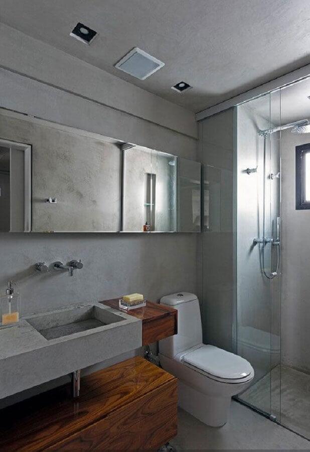 banheiro masculino decorado com cimento queimado e armário suspenso de madeira Foto Pinterest