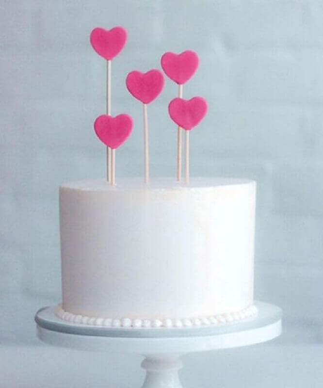 simple cake decoration with heart plaques on top Photo A Thousand Mom Tips