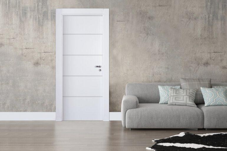 decoração moderna com parede de cimento queimando sofá cinzza
