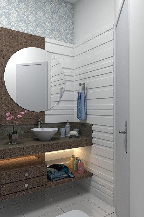 espelho redondo para banheiro decorado com cuba branca e papel de parede Foto Ismael Ceolin Salvador