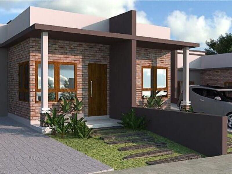 fachada de casa geminada pequena com revestimento de tijolinho Foto Pinosy