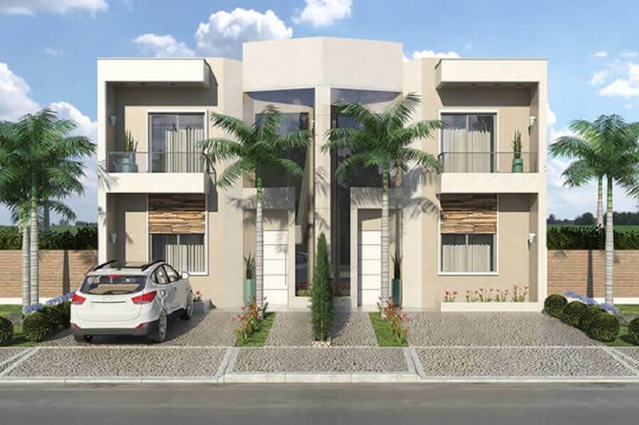 fachada de casas geminadas modernas com coqueiro e sacada de vidro Foto Entenda Antes